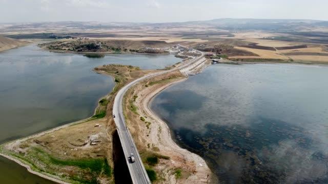 view of 'hirfanli' dam in the kirsehir region, kirsehir/turkey - hydroelectric power stock videos & royalty-free footage