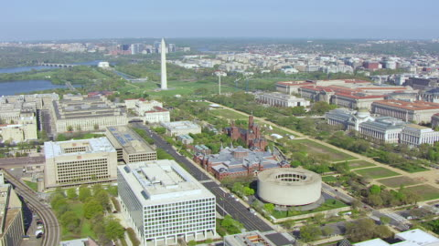 ws aerial pov view of hirshhorn museum and smithsonian institution building, washington monument and national mall seen in background / washington dc, united states  - smithsonian institution stock videos & royalty-free footage