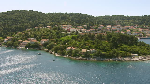 ws aerial view of historic fortified town along adriatic sea / korcula, dubrovnik neretva county, croatia - adriatic sea stock videos & royalty-free footage
