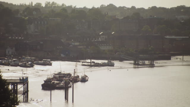 ws view of historic harbour near town / chatham, kent, united kingdom - イングランド ケント点の映像素材/bロール