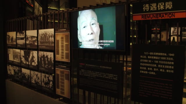 view of historic photos and documentary film of unit 731 in the exhibition hall of crime evidence of japanese germ factory on may 19, 2017 in harbin,... - documentary film stock videos & royalty-free footage
