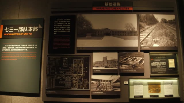 a view of historic photos of headquarters of unit 731 in the exhibition hall of crime evidence of japanese germ factory on may 19 2017 in harbin... - ドキュメンタリー映画点の映像素材/bロール