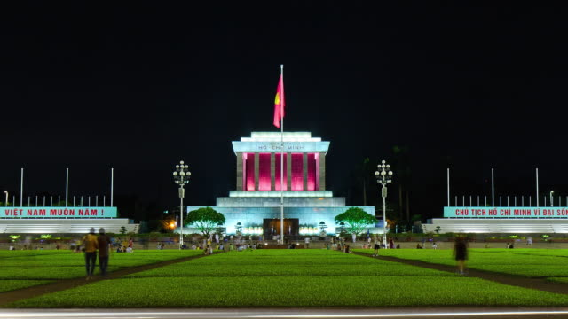 ms t/l zo view of ho chi minh's mausoleum building at nightfall with grass / hanoi, vietnam - hanoi stock videos and b-roll footage