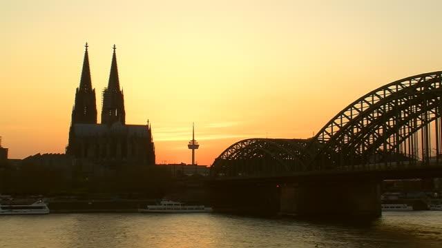 WS View of Hohenzollern Bridge, Rhine and Dom at sunset / Cologne, North Rhine Westphalia, Germany