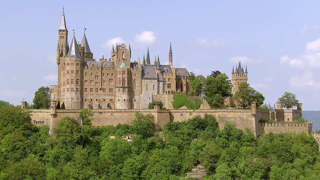 ws aerial ds zo view of hohenzollern castle on top of mount hohenzollern / bisingen, baden wurttemberg, germany - kirchturmspitze stock-videos und b-roll-filmmaterial