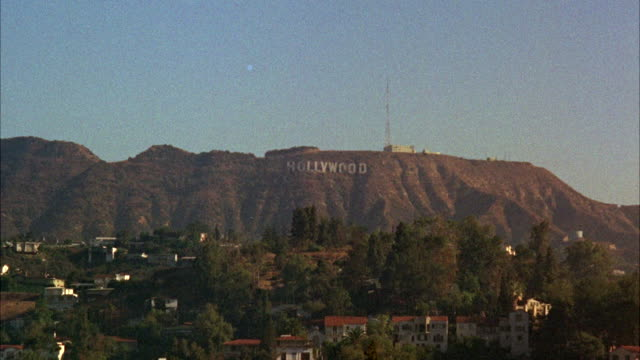 stockvideo's en b-roll-footage met ws view of hollywood sign on hillside and part of city - 1965