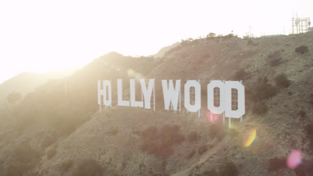 ws aerial view of hollywood sign on mountain - hollywood sign stock videos & royalty-free footage