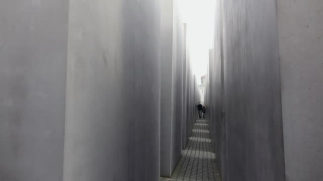 ms view of holocaust memorial, memorial to the murdered jews of europe / berlin, germany - gemeinsam gehen stock-videos und b-roll-filmmaterial