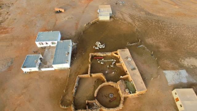 vidéos et rushes de aerial view of homes of the herdsmen on gobi desert/inner mongolia, china. - désert de gobi