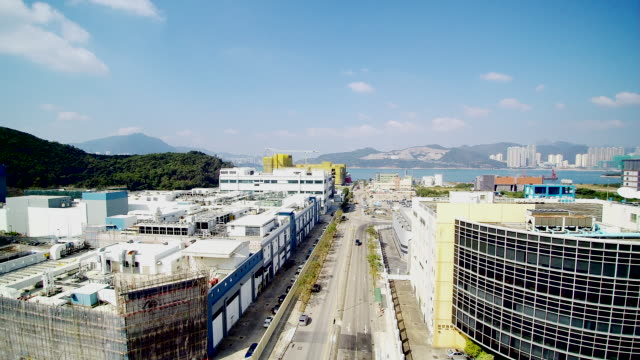 vídeos de stock e filmes b-roll de ws aerial pov view of hong kong industrial park / hong kong, china  - pano de protecção