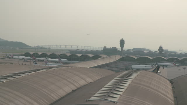 view of hong kong international airport exterior - hong kong international airport stock videos and b-roll footage