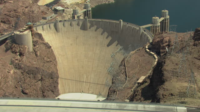 ws aerial view of hoover dam and bypass with cars driving / arizona, united states - hoover dam stock videos and b-roll footage