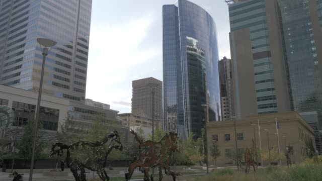 View of horse sculptures in Courthouse Park and buildings on 7th Avenue, Calgary, Alberta, Canada, North America