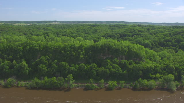WS AERIAL POV View of Horseshoe Bluff, landscape in background / Dubuque County, Iowa, United States