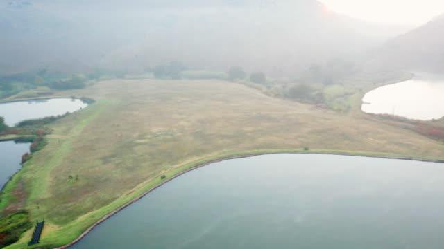 WS PAN View of hot air balloon flight at sunrise over gauteng province / Magaliesberg , Gauteng, South Africa
