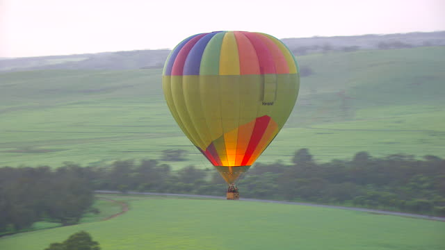 ws aerial ts view of hot air balloon flying over landscape / kings cliff, new south wales, australia - hot air balloon stock videos & royalty-free footage