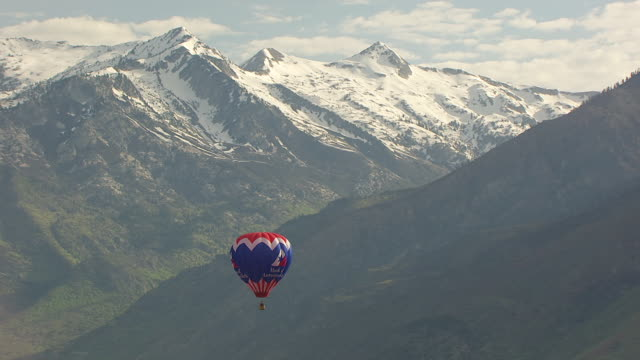 MS AERIAL View of hot air balloon with Wasatch mountain range / American Fork, Utah, United States