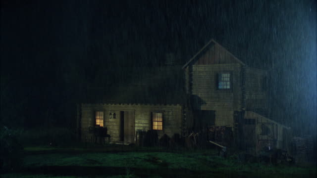 vidéos et rushes de ms view of house in rain at night / unspecified - house