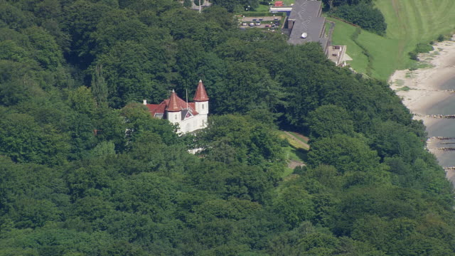 ws aerial zi zo view of house near coast / arhus, denmark - küste stock-videos und b-roll-filmmaterial