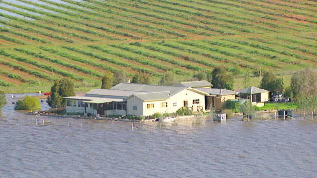 WS AERIAL ZI ZO DS View of house with floods / Griffith, New South Wales, Australia