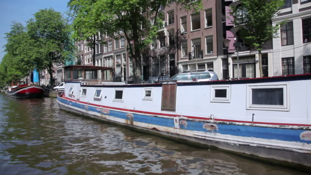WS POV View of houseboats docked near canal / Amsterdam, The Netherlands, Holland