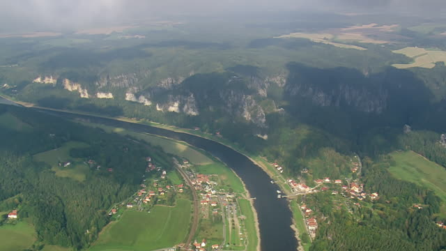 ws aerial view of houses and farm field near elbe river with hills / germany - river elbe stock videos & royalty-free footage