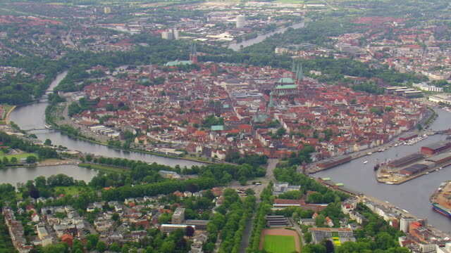 ws aerial view of houses and road way at lubeck / germany - lübeck stock-videos und b-roll-filmmaterial