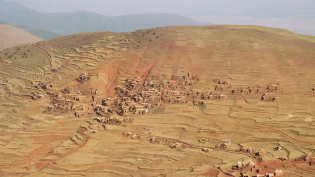 vidéos et rushes de view of houses and terrace fields in the mountainous region of north morocco, africa - maroc
