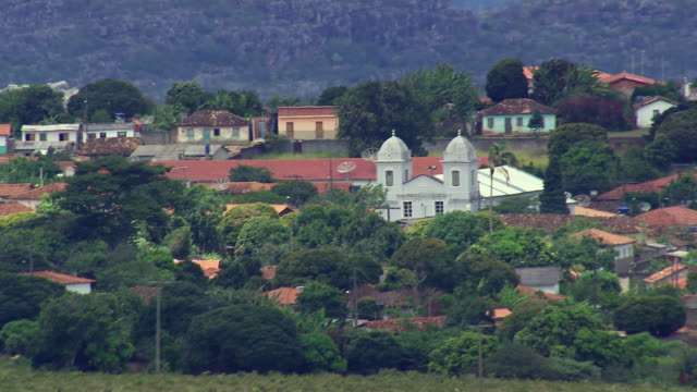 ms aerial view of houses and trees / minas gerais, brazil - minas stock videos and b-roll footage