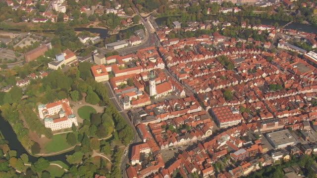 ws aerial view of houses and trees with celle schloss / germany - deutsche kultur stock-videos und b-roll-filmmaterial