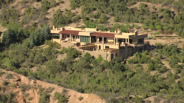 WS AERIAL View of houses built in to foothills / Santa Fe, New Mexico, United States