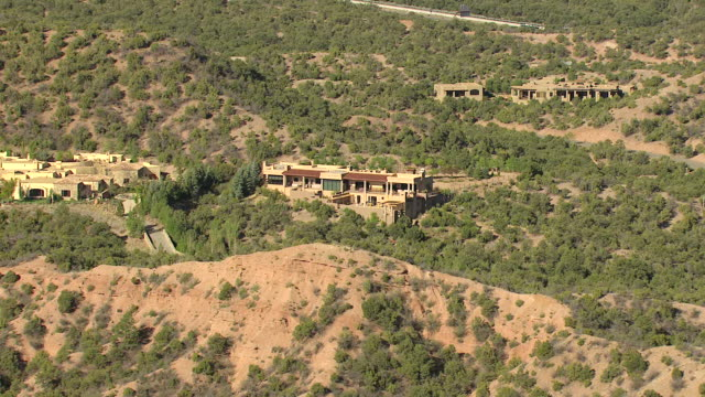 ws aerial view of houses built into foothills / santa fe, new mexico, united states - foothills stock videos & royalty-free footage