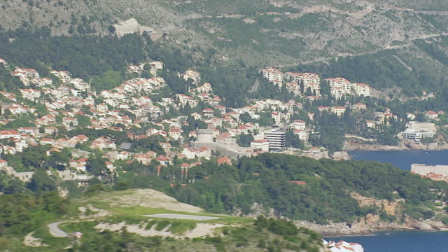 ms aerial view of houses in city on adriatic sea / dubrovnik, dubrovnik neretva county, croatia - adriatic sea stock videos & royalty-free footage