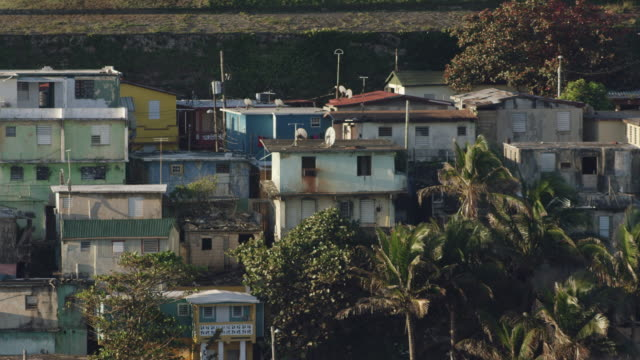 ws aerial pov view of houses in slum / la perla, old san juan, san juan, puerto rico, united states - puerto rico stock videos and b-roll footage