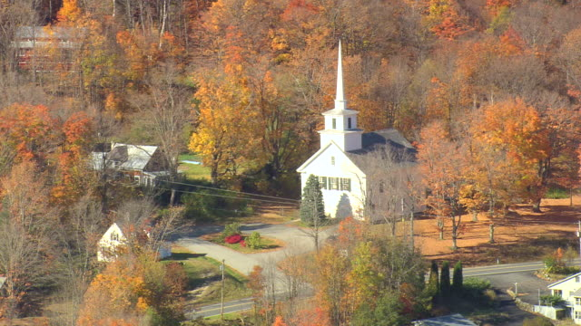MS AERIAL ZO View of houses surrounded by autumn color trees at Green Mountain Nat Forest / Vermont, United States