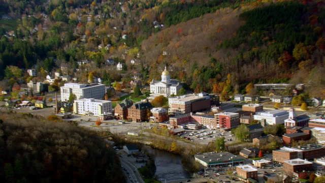MS AERIAL PAN ZI View of houses with autumn color trees in Montpelier city / Vermont, United States