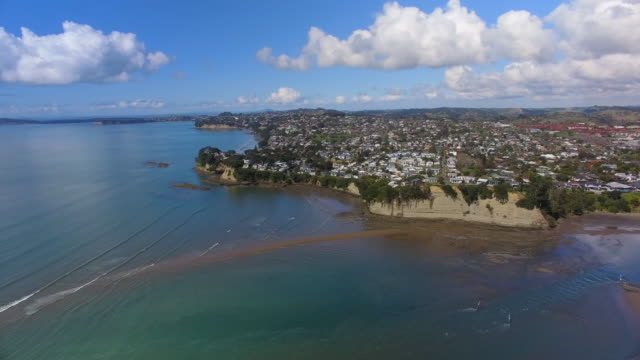 View of housing along the coast at Orewa, Beach, Auckland, New Zealand.