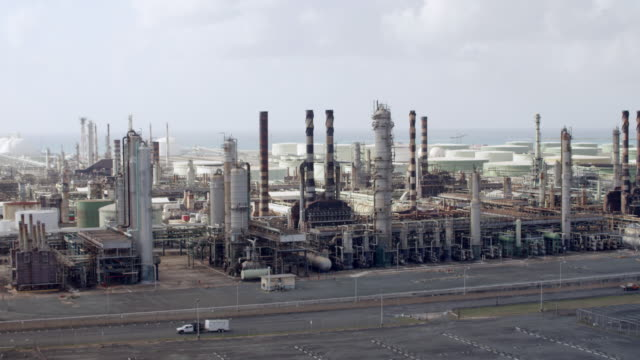WS AERIAL POV View of Hovensa Oil Refinery with storage tanks / St Croix, US Virgin Islands, United States
