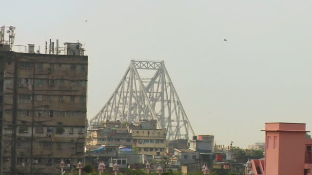 ms zo view of howrah bridge and city  / kolkata, west bengal, india - howrah bridge stock videos & royalty-free footage