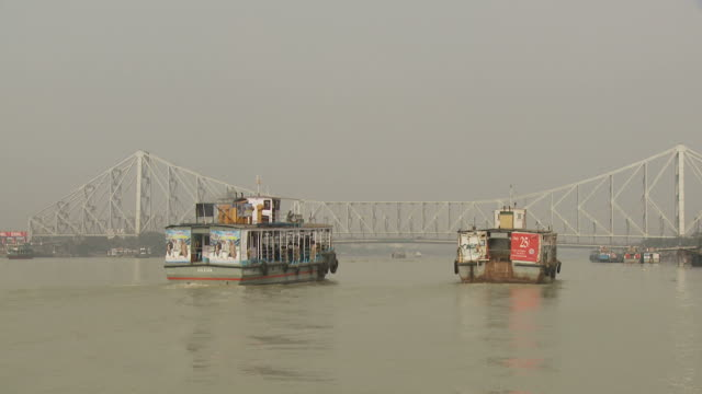 view of howrah bridge in kolkata india - kolkata stock videos & royalty-free footage