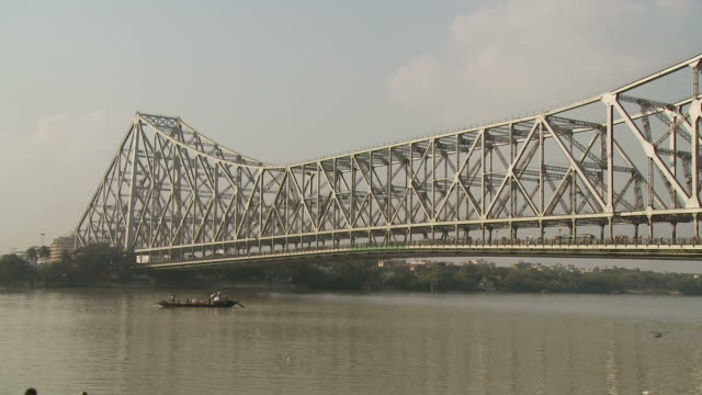 view of howrah bridge in kolkata india - howrah bridge stock videos & royalty-free footage