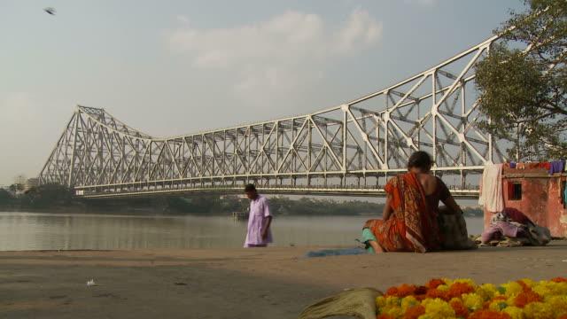 view of howrah bridge in kolkata india - kolkata stock videos & royalty-free footage