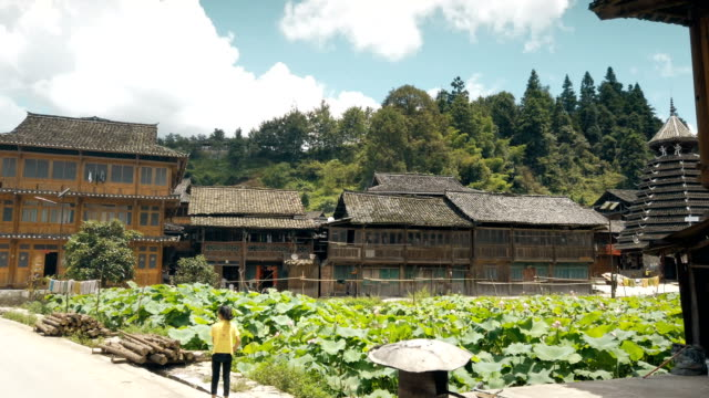 view of huganggang dong village, guizhou, china - timber stock videos & royalty-free footage