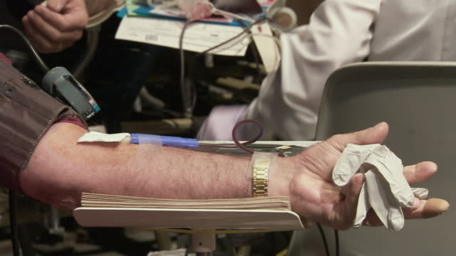 cu view of human arm with blood being drawn / rutland, vermont, usa - human arm stock videos & royalty-free footage