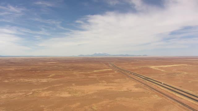 ws aerial view of humphrey peak along route 40 / arizona, united states - südwestliche bundesstaaten der usa stock-videos und b-roll-filmmaterial