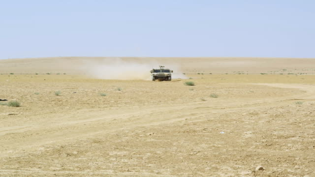 WS PAN View of Humvee running on Desert road / Desert, Jordan