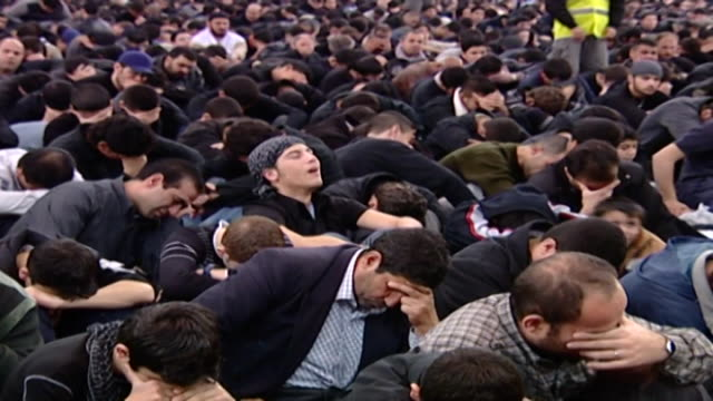 view of hundreds of men and boys in an ashura majlis ashura is held every year on the 10th day of muharram commemorating the death of hussain ibn ali - ashura muharram stock videos & royalty-free footage