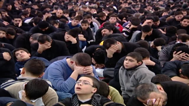 view of hundreds of young men in an ashura majlis ashura is held every year on the 10th day of muharram commemorating the death of hussain ibn ali - ashura muharram stock videos & royalty-free footage