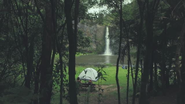 View of Hunua Falls through trees.