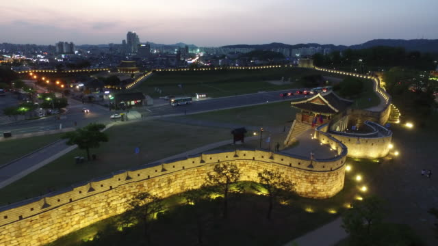 view of hwaseong fortress (unesco world heritage) in suwon at night time - hwaseong palace stock videos and b-roll footage